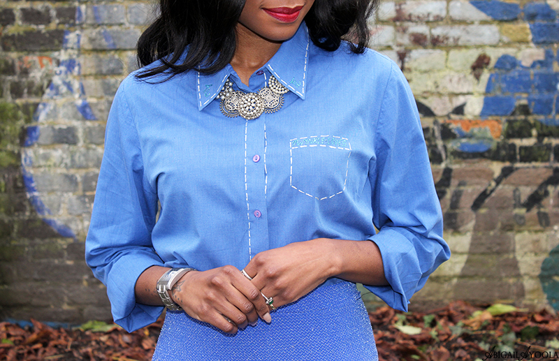 WEARING A BRIGHT BLUE OUTFIT