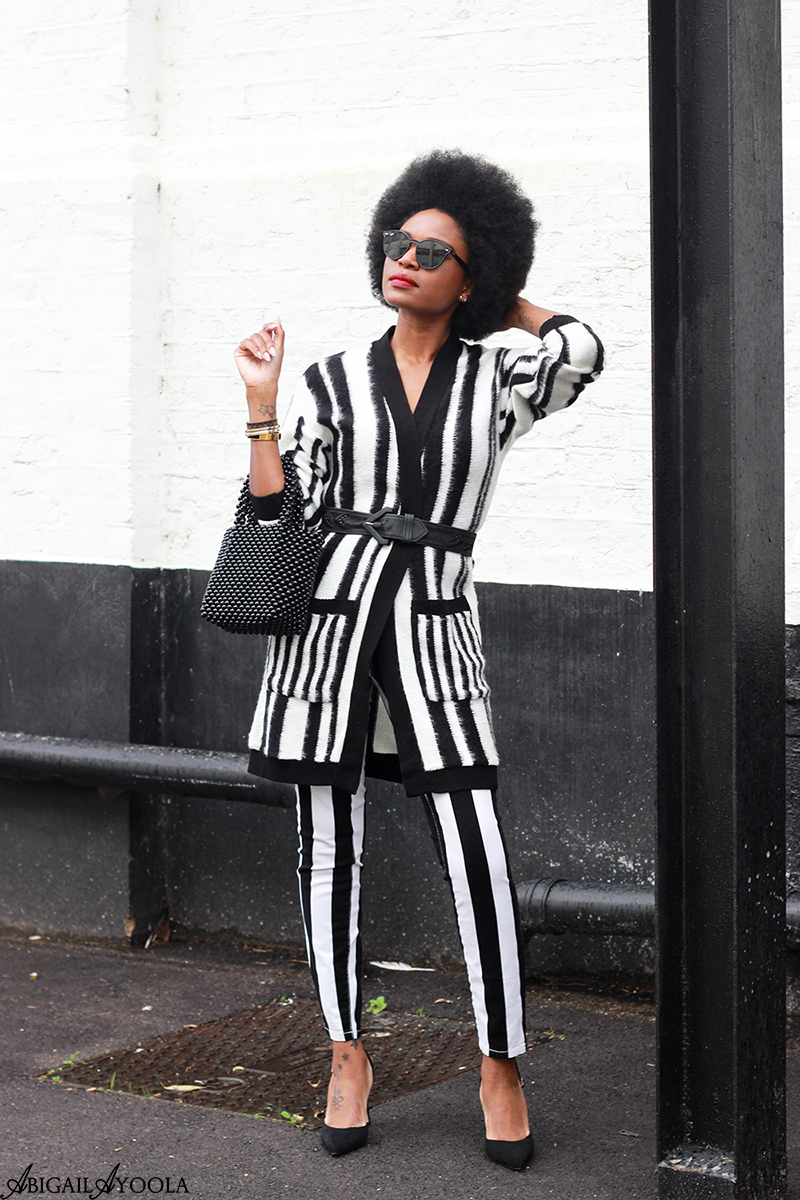 Fashion Blogger Abigail Ayoola Wearing Double Stripes Outfit in the Christmas Spirit
