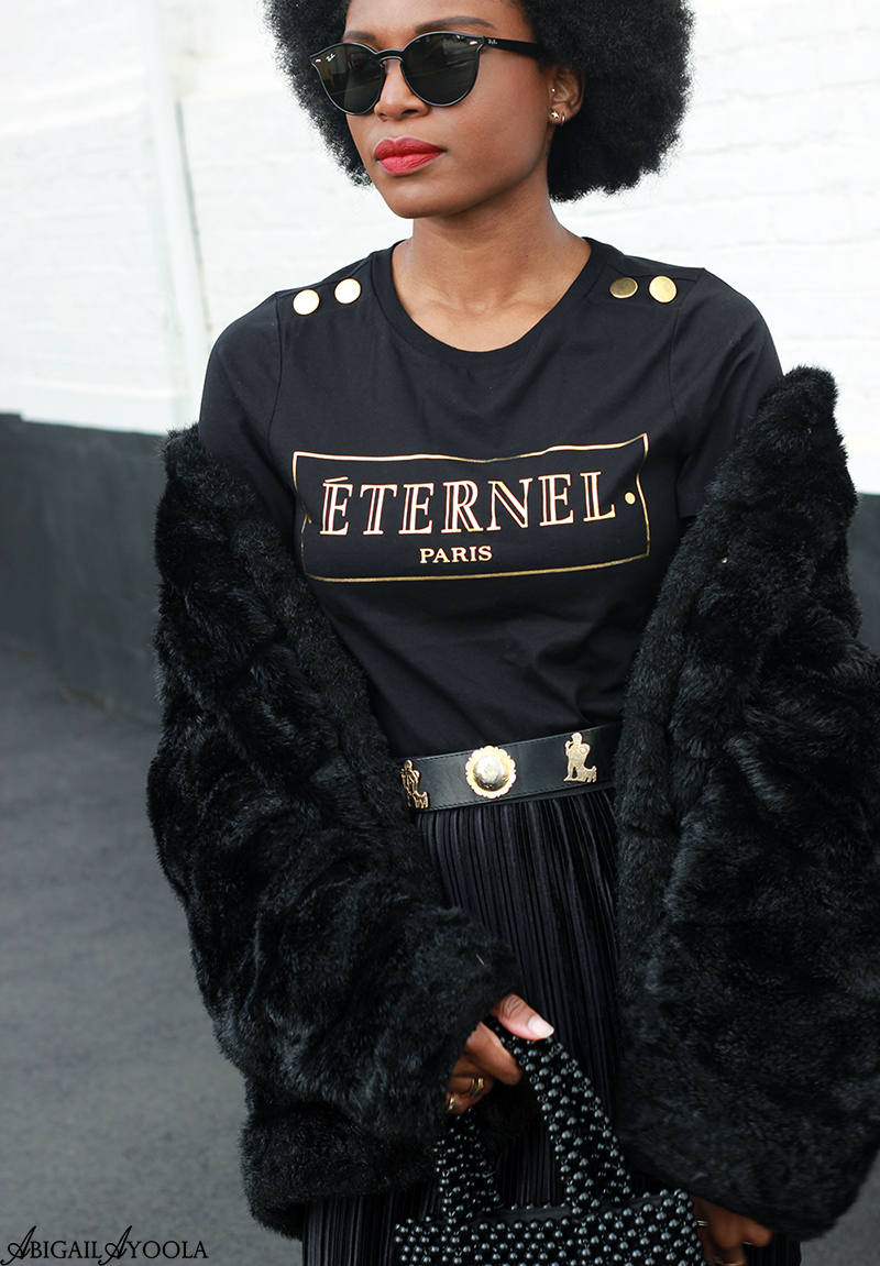 FASHION BLOGGER ABIGAIL AYOOLA WEARING BLACK & GOLD PRINT T-SHIRT AND VELVET SKIRT