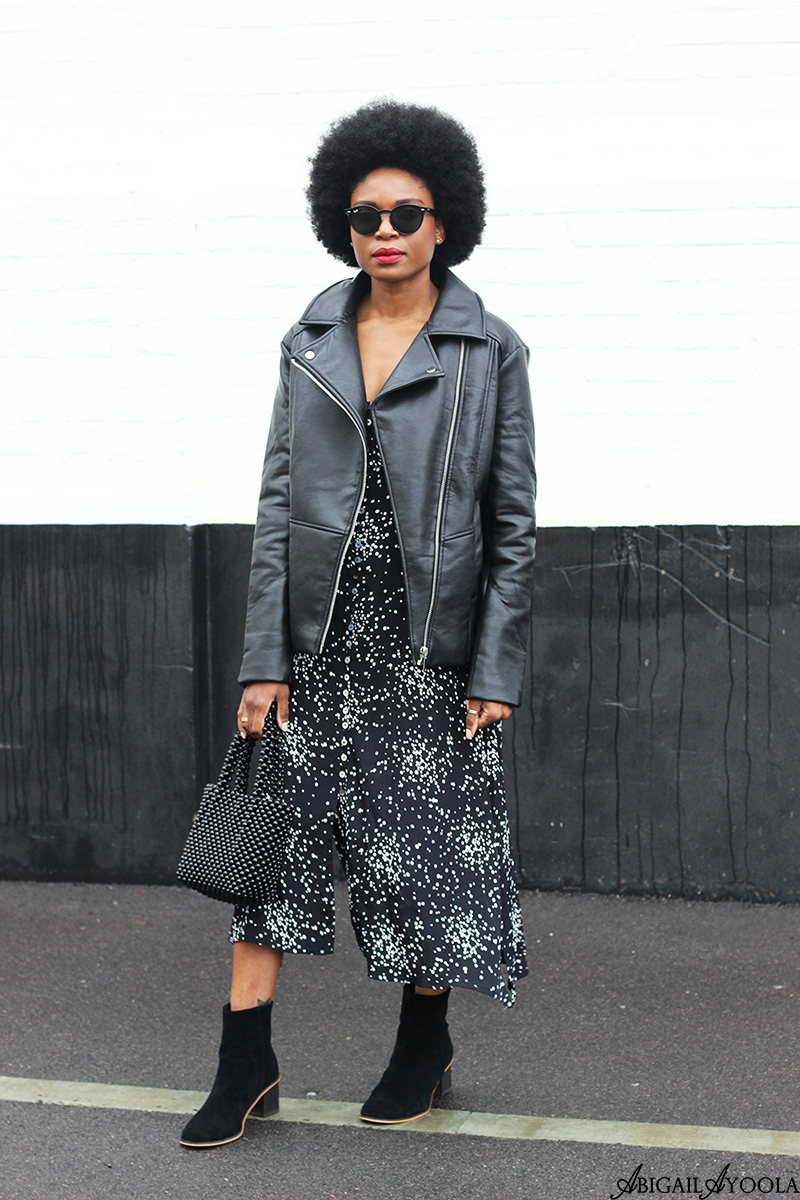 Fashion Blogger Abigail Ayoola Wearing Spot Print Dress and Oversized Leather Jacket